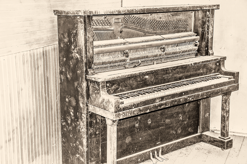 """An upright piano left to stand in an abandoned building.<br /> <br /> You can own this print as wall decor or other products.  Click the """"buy"""" button to browse."""