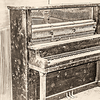 "An upright piano left to stand in an abandoned building.<br /> <br /> You can own this print as wall decor or other products.  Click the ""buy"" button to browse."