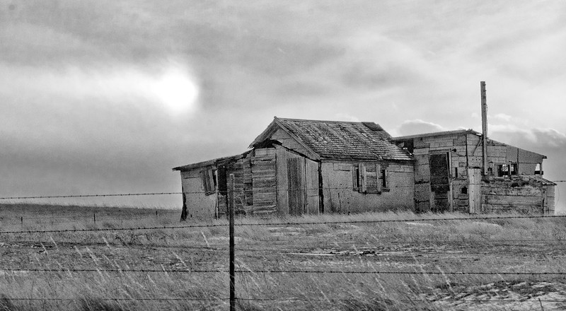 """Added on to at least four times, an abandoned shack west of Watford City.<br /> <br /> You can own this image as a print, or other product. Just click """"buy"""" to browse products available with this image."""