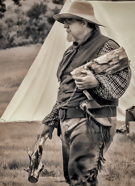 """Buckskinner carrying firewood to his campfire.<br /> <br /> You can add this image to your collection, just click the """"buy"""" button to browse your options.  Or as a keepsake, coffee cup, mouse pad or other items."""