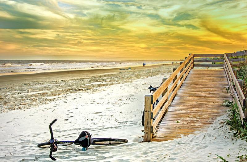 Boardwalk on Kiawah Island beach at sunset.