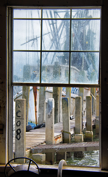 Reflection through the window of a shrimp boat at Cherry Point on Wadlamaw Island in SC
