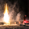 KRISTOPHER RADDER - BRATTLEBORO REFORMER<br /> Ben Carter, assistant pyrotechnic for Northstar Fireworks, lights a firework during the New Year's Eve firework show over the Retreat Meadows in Brattleboro, Vt., on Saturday, Dec. 31, 2016.