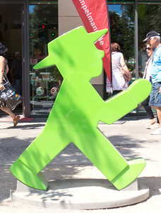 Ampelmannchen - the Green walk and the red don't walk man on the street crossing signs from old East Berlin days.  They are so popular, they have stores that sell their merchandise (anything you could want with one on it from purses to underwear).  This is a statue of one.
