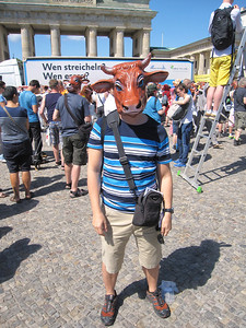Me wearing one of the masks of the Vegan Protesters at the Brandenburg Gate.