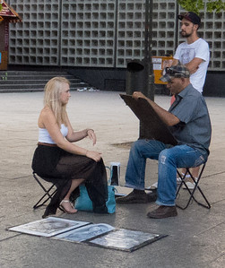 Portrait artists in the square