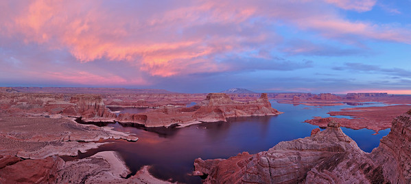 Alstrom Point sits above Gunsite Bay on Lake Powell. On the fourth evening there this year, high clouds turned a nice pink at sunset and gave their glow to the sandstone buttes below.  Lake Powell was the highest it has been in ten years, so I wanted to get this image before drought and water releases took their toll on the lake level again.