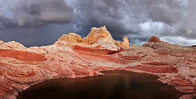Storm in the Pocket. A summer monsoon storm rises behind the sandstone of the Paria Plateau.