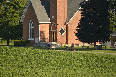 Bikers in front of country church