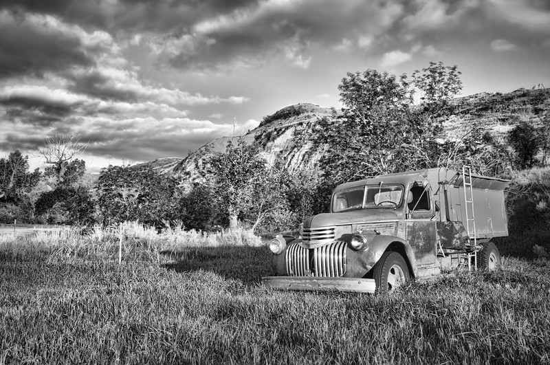 Along a gravel road that snakes along side the Little Missouri River, a ranch parks its 70-year old Chevrolet farm truck under a hillside