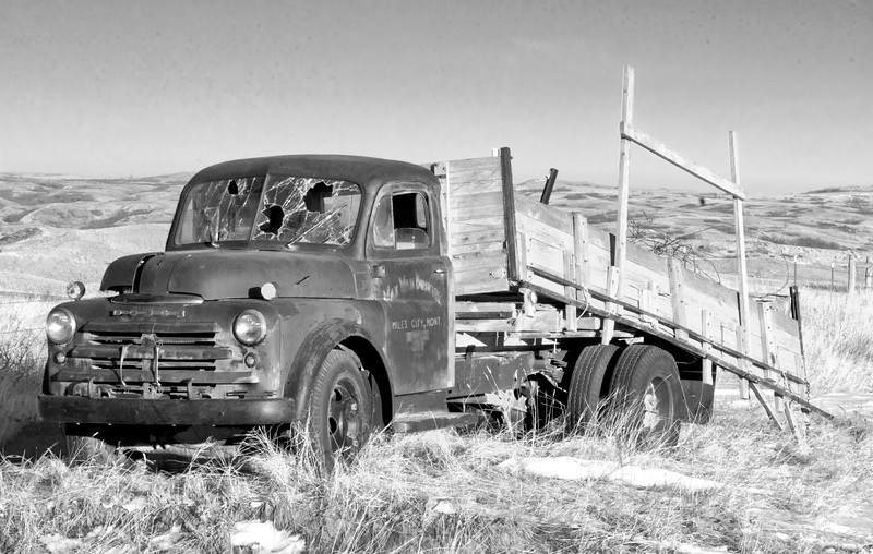 Between Mandaree and Skunk Bay, a Miles City, Montana deliver truck rests in peace -- well almost in peace.  A few bullet holes have ventilated the windshield.  Below the hills, the Little Missouri River meets Lake Sakakawea.