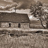 All the other buildings on the farmstead are gone, one still in a trash heap, but the stone house remains tall and strong,