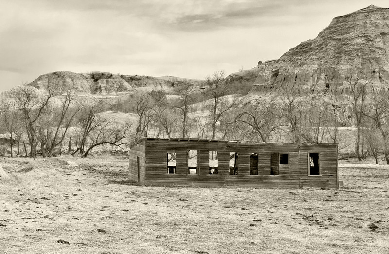 An abandoned shed without roof, glass, doors or floor rots away in the Badlands of North Dakota in Dunn County