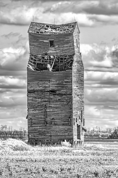 "An abandoned wooden grain elevator in southern Trail County ND<br /> <br /> You can own this image. To browse the products available, just click the ""buy"" button to see the wall decor and keepsakes."