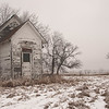 An abandoned school house marks the site of the Pondersosa Saddle Club -- long unused, stands stark in the winter's cold.  The Saddle Club is midway between Denhoff and Anamoose near Goodrich, North Dakota.