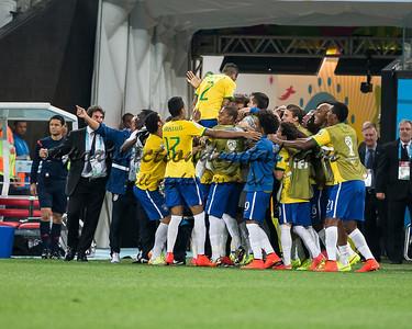 Brazilian players celebrate a goal.