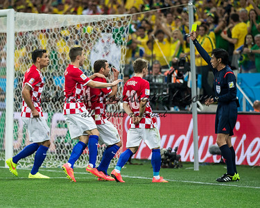 Croatian players protest to the referee.
