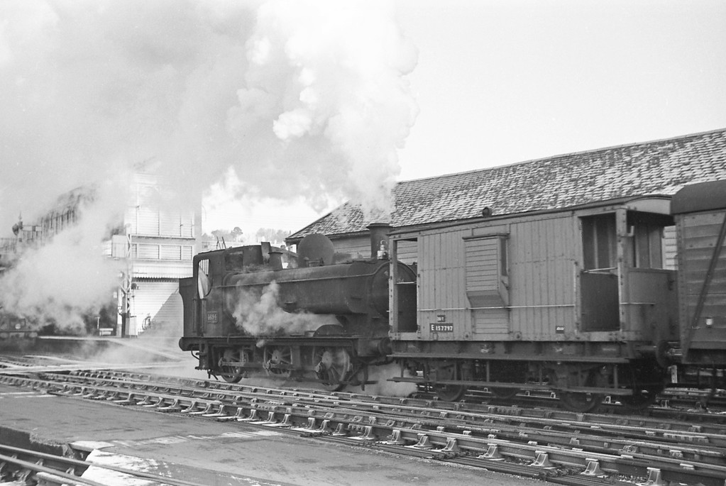 4694, banking up freight hauled by 31842,  Exeter St David's, December 21, 1963.