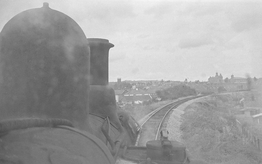 Cab shot from 1421, Exeter St David's-Dulverton, approaching West Exe Halt, Tiverton, autumn, 1963. The prominent building is Tiverton Town Hall.