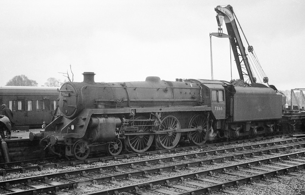 73166, departmental involved in dismantling work at Stoke Canon Station, near Exeter, winter, 1963. Engine is at the up platform; coach is at the Exe Valley branch platform. Lines in foreground are up and down throughs.