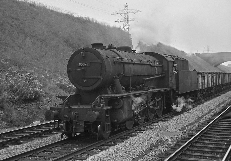 90073, northbound coal empties, Filton Bank, Bristol, August 13, 1964. Loco carrying a Doncaster 36A shedplate. Picture taken from a passing Warship-hauled Plymouth-Liverpool Lime Street train.