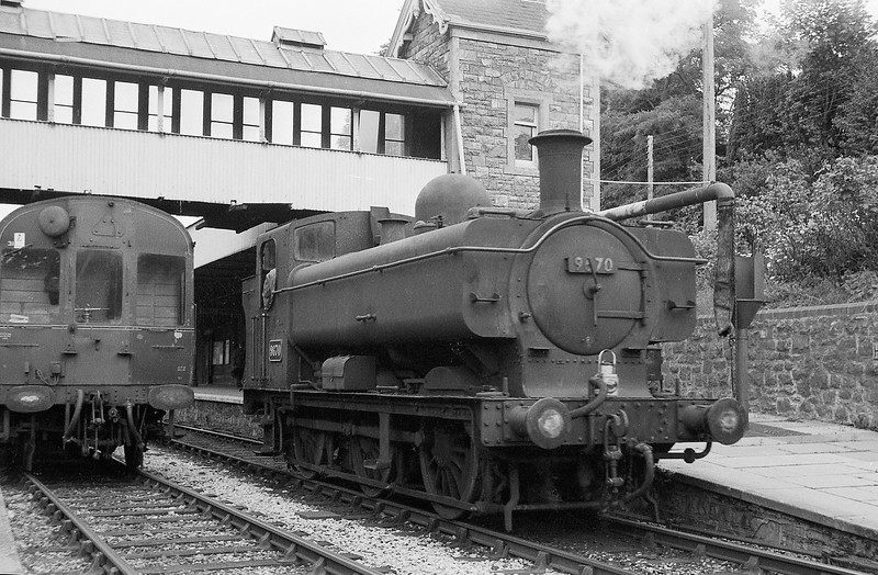 9670, running round Tiverton-Tiverton Junction branch auto coaches, Tiverton Station, summer 1964. Extremely unusual, if not unprecedented in last years of steam, for a Pannier Tank to work passenger trains on Tiverton Junction branch.