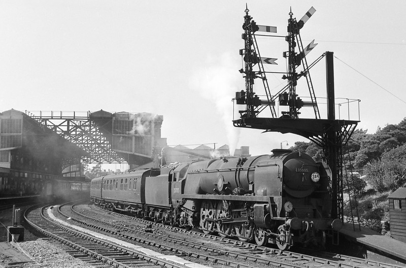 35005, Canadian Pacific, Weymouth-London Waterloo, taking water at Bournemouth Central, September 1, 1964.