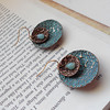 """Double Round Disc Earrings with a Swirl Design, Turquoise Patina on the Larger Disc and Amazonite Stone in the Center<br /> <br /> ~ Made by Alasha Lantinga<br />  <a href=""""http://www.facebook.com/saffirejewelry"""">http://www.facebook.com/saffirejewelry</a><br />  <a href=""""http://www.alashalantinga.com"""">http://www.alashalantinga.com</a>"""