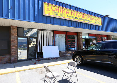 Damage to China Maxim Restaurant from vehicle running into building earlier in the day. The damaged area is the restaurant's office. (SUN/Julia Malakie)