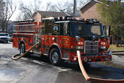Friendship's Engine 1 pumps water at a working structure fire in Winchester in January of 2012.