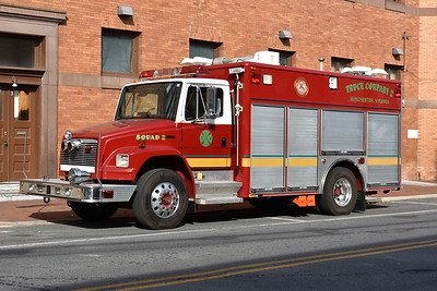 """Winchester Rouss Fire Company - Squad 2 - In November of 2016, the Rouss Fire Company purchased this 2001 Freightliner 70/Pierce from Fairfax County, Virginia, where it ran as Light/Air 437.  During the winter of 2016/2017, Rouss members made modifications to the truck to equip it as their Squad 2.  For example, the extrication equipment carried on one of the ladder trucks is now on this truck, thus Squad 2 handles auto accidents.  A note of history on this truck - the department decided not to paint Squad 2 in the Rouss green/white due to the expense of repainting.  The Rouss members focused on purchasing tools and equipment for Squad 2.  Since it is not painted in the traditional green/white, you will not see the """"Rouss"""" name on the truck.  This continues a long time tradition of non green/white apparatus at Rouss."""