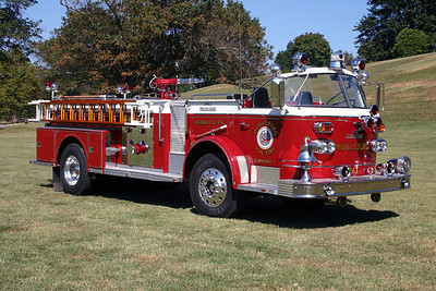 The officer side view of the old Rouss 1963 American LaFrance engine.