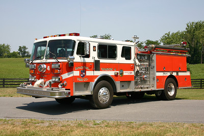 This 1987 Seagrave HB once ran at Boyce (Clarke County, VA).  In 1996, Delmarva rehabed this engine and changed the paint from red and white to this orange and white.  It is equipped with a 1500/500.