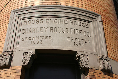 The Rouss fire station sign found on the corner of the station building.