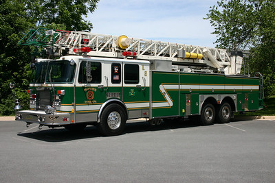 Ladder 2 at Rouss is this 1992 Spartan Gladiator/LTI 105' rearmount.  This truck was purchased from Elmira, New York where it was painted red and white.  Photographs of both Truck 2 and Ladder 2 were taken in 2010 at a parking lot just off of Amherst Street.