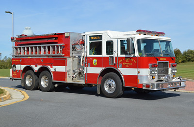 An officer side view of Tanker 1 from Berryville, a 2002 Pierce Dash 1250/2500 with job number 13496.