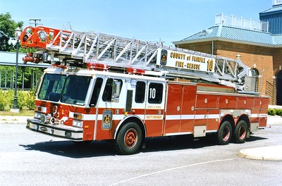 Former Truck 10, a 1984 E-One Hurricane/1997 E-One, 135', sn- 17019, Shop #7012.  Rehab included 4-door addition, new jack system, a reconditioned aerial, and air conditioning.