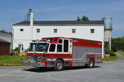 The Boyce house siren, and the towns water tower in the background of Squad 4.
