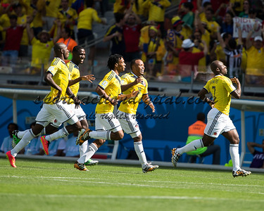 Colombian players celebrate a goal