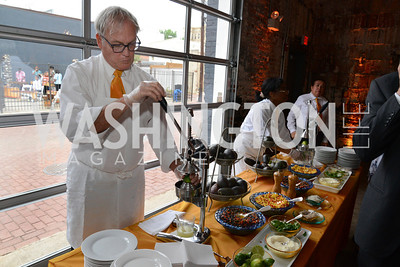 Waiter mixes up a batch of guacamole for the guests. E.L. Haynes Toast to Transformation Celebration. Long View Gallery. May 14, 2014. Photos by Neshan H. Naltchayan