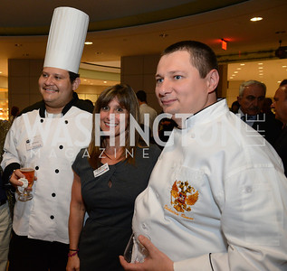 Chef Edgar Melendez (El Salvador), Theresa Belpulsi and Chef Roman Shchadrin (Russian Federation). Embai and ssy Chef Challenge. Ronald Reagan Building. May 15, 2014. Photo by Neshan H. Naltchayan