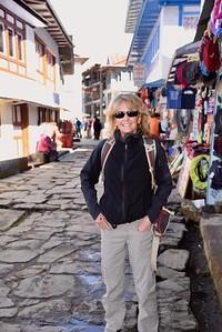 Laurie Kelley on street in Lukla