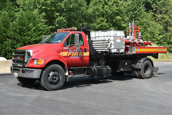 "Fairfax City, Virginia Foam Support 433 (although marked 443) - a 2003 Ford F750/Wilbar Truck Equipment/Stellar Shuttle (hoist system).  FS 433 carries two 265 gallon foam tanks, and can carry other tanks stored at the training center.  This is a ""POD"" - Platform on Demand - setup, where FS 433 can unload the rear portion at the scene of an emergency.  FS 433  is a supply piece, able to provide foam to another truck (i.e Foam Engine 433) or the department's foam trailer (Foam Support 433B)."
