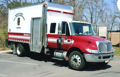 Logistics Service 2, a 2003 International 4300/Morgan, Shop #6505.