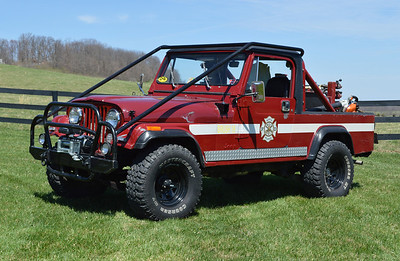 Brush 19 at North Mountain, as photographed in April of 2014. This 1985 Jeep Scrambler originally was delivered to Fairfax County, Virginia where is was assigned to the Penn Daw Station (Station 11) and then to Great Falls (Station 12). In 2011, Off Road Innovations completed a variety of enhancements to Brush 19, including roll cage, axels/tires, and front winch. It is equipped with a 60 gpm pump and carries 100 gallons of water. Photographed in June of 2014.
