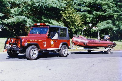 Utility 12, a 1995 Jeep Cherokee, towing Boat 12-1, a Zodiac.