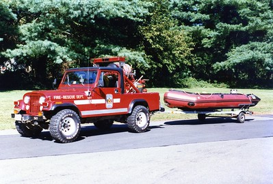Former Jeep 12, a 1985 Jeep, 150gwt.  Shown towing Boat 12-2, a Zodiac inflatable.  Shop #5477.