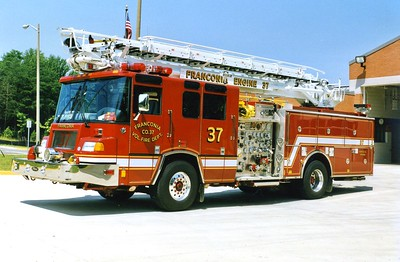 """Former Engine 37, a 1996 Pierce Quantum, 1500/500, 65', sn- E9776.  Returned from Pierce after having rear axel moved ahead 18""""."""