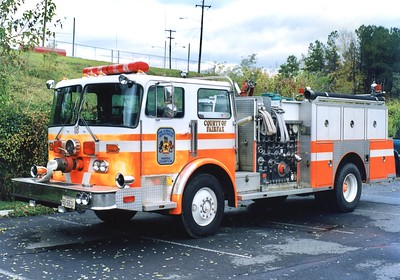 """Former Engine 7, a 1982 Duplex/3D/Fire Force/1989 Duplex, 1000/500, Shop #7097.  Painted in the former """"German Orange"""" paint scheme that did not catch on in Fairfax County."""