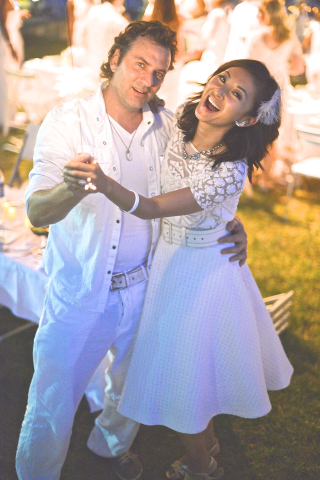 Michael Clements, Anchyi Wei, The global phenomenon secret dinner party, Diner en Blanc, attracted over 1,300 guests all wearing white.  The Yards Park, Thursday, September 4, 2014.  Photo by Ben Droz